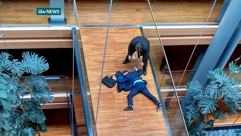 A handout picture released by ITV NEWS on October 6, 2016 shows UK Independence Party MEP, Steven Woolfe, lying face-down on a walk-way inside the European Parliament building in Strasbourg in eastern France. (AFP Photo)