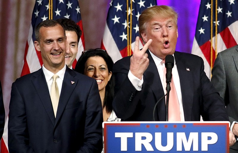 Republican U.S. presidential candidate Donald Trump's campaign manager Corey Lewandowski (L) looks on as Trump speaks (Reuters Photo
