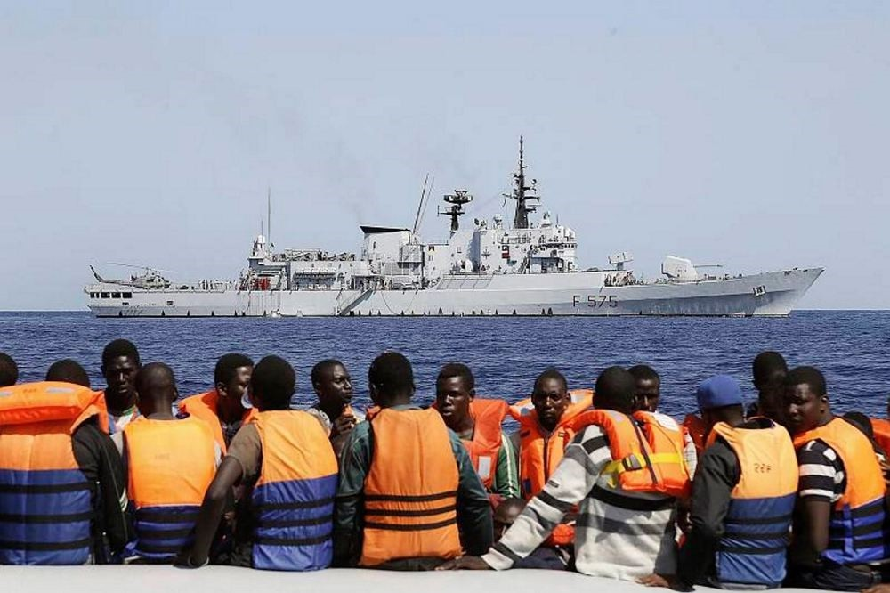 Sub-Saharan migrants transported to an Italian Navy vessel during a rescue operation in the southern Mediterranean Sea. (EPA Photo)