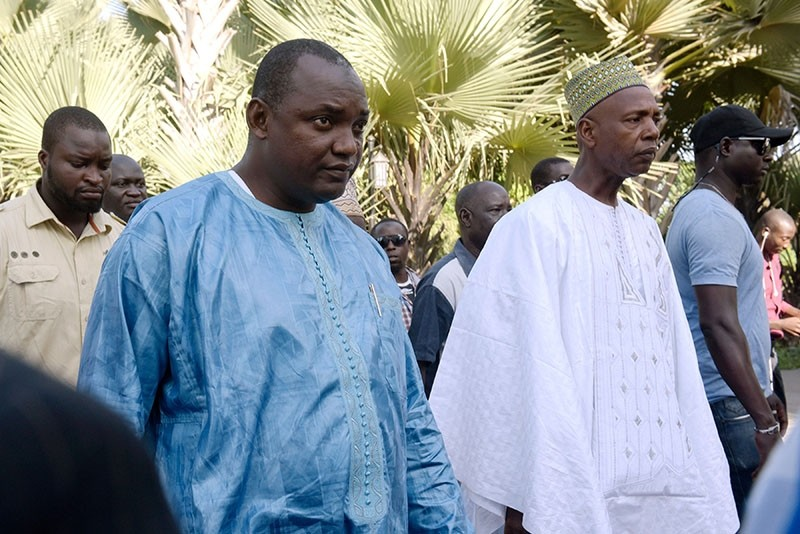 This file photo taken on December 13, 2016 shows Gambian president-elect Adama Barrow, flanked by his supporters, arriving at a luxury hotel in Banjul. (AFP Photo)