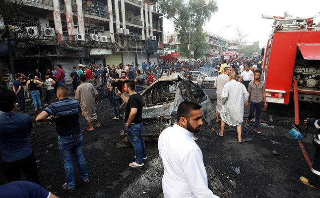 People gather at the site of a suicide car bomb in the Karrada shopping area, in Baghdad, Iraq, July 3, 2016. (Reuters Photo)