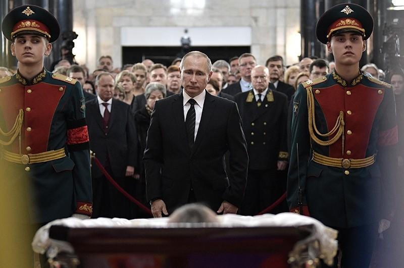 Russian President Vladimir Putin, center, attends a farewell ceremony for the Russian Ambassador to Turkey Andrei Karlov at the Foreign Ministry headquarters in Moscow, Russia, Thursday, Dec. 22, 2016 (AP Photo)