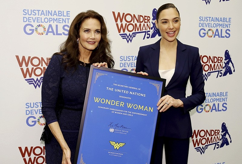In this image released by Starpix, actress Lynda Carter, who starred in the 1970s series,,Wonder Woman,, left, and actress Gal Gadot (AP Photo)