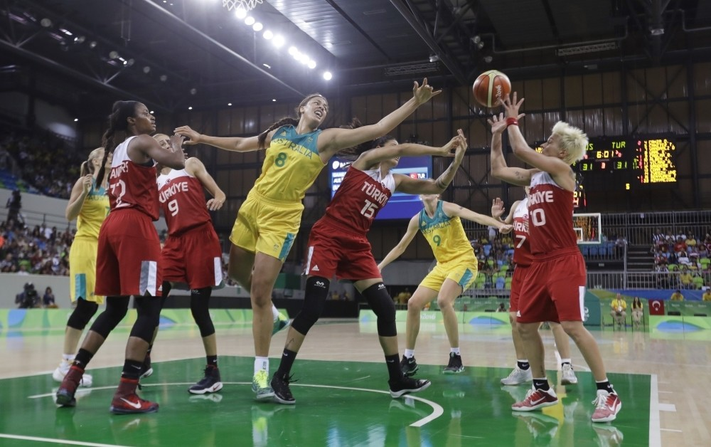 Australia center Liz Cambage (8), Turkey forward Tilbe u015eenyu00fcrek (15) and Iu015fu0131l Alben reach for the rebound during the second half of a women's basketball game at the Youth Center at the 2016 Summer Olympics in Rio de Janeiro.
