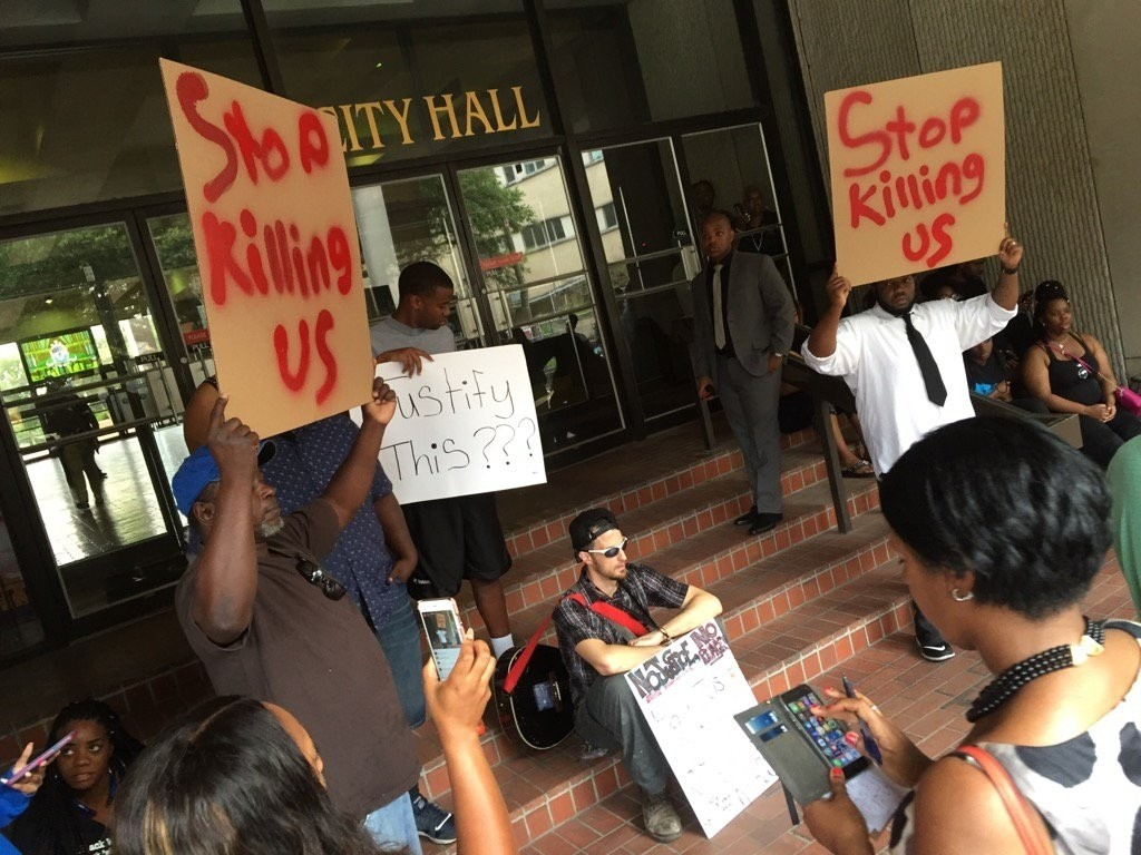 Protesters gather at City Hall in Baton Rouge over the shooting of Alton Sterling Wednesday, July 6, 2016, shortly before a press conference with local leaders. (AP Photo)