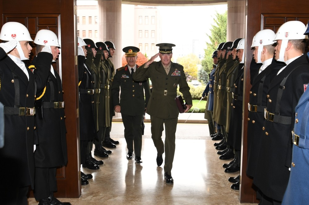 Chairman of the Joint Chiefs of Staff Gen. Dunford (R) paid a surprise visit to Ankara to discuss developments in Iraq and Syria.