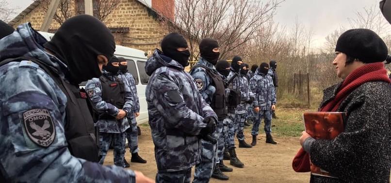 RUSSIA RAIDS HOMES OF CRIMEAN TATARS, DETAINS AT LEAST 20