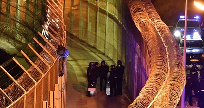 pMore than 50 Moroccan and Spanish border guards were injured repelling around 1,100 African migrants who attempted to storm a border fence and enter Spain's North African enclave of Ceuta, Spanish...
