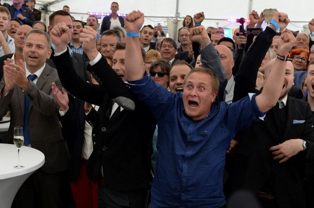 Members and supporters of the AfD party reacted after first exit polls in Schwerin, Germany, Sept. 4 after the state elections in Mecklenburg-Western Pomerania.