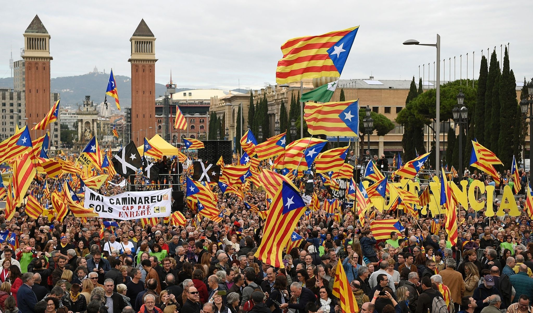 This file photo taken on November 13, 2016 shows pro-independence demonstrators holding flags during a demonstration. (AFP Archive Photo)