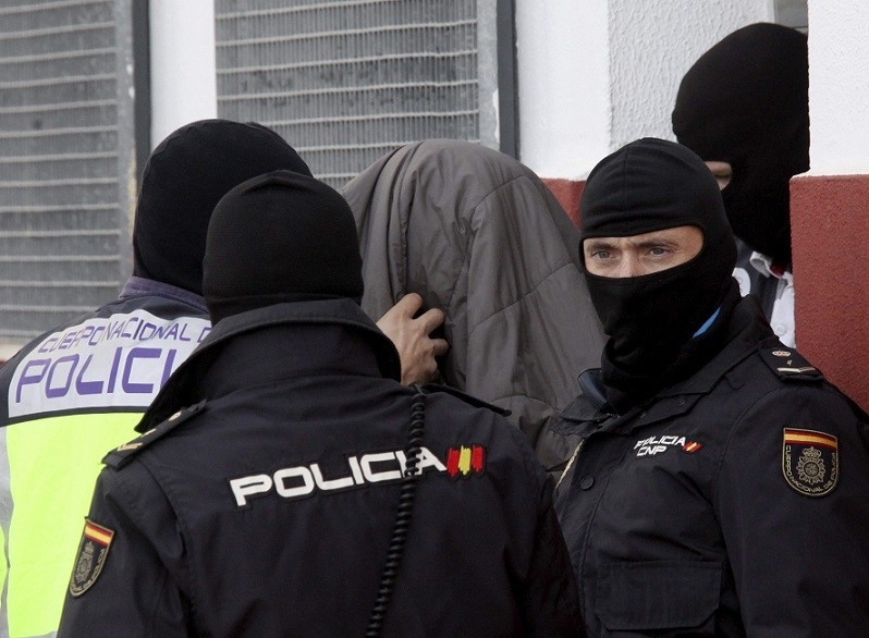 An alleged Daesh-linked terrorist is arrested by Spanish police officers in Ceuta, Spain, Nov. 9 2016. (EPA Photo)