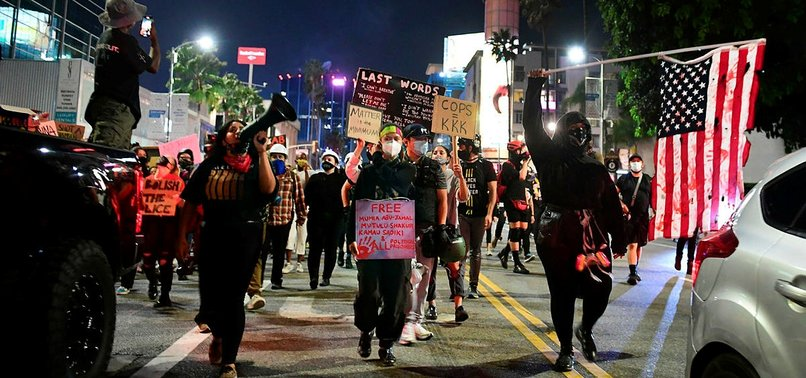 US PROTESTERS DEFY SECOND NIGHT OF CURFEW IN BREONNA TAYLOR PROTEST