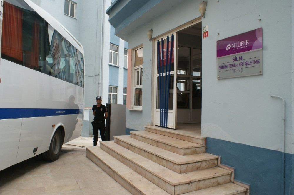 A police officer stands outside a Gu00fclen-linked school after a raid in the western city of Bursa.
