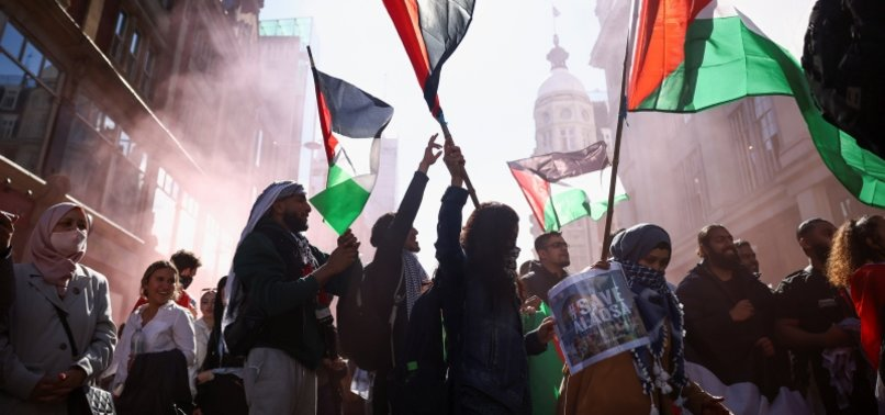 THOUSANDS OF PRO-PALESTINIAN PROTESTERS TAKE TO LONDON AND MADRID STREETS TO CONDEMN DEADLY ISRAELI AIR RAIDS ON GAZA STRIP
