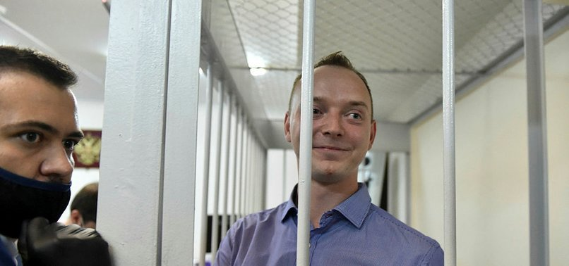 RUSSIAN SPACE OFFICIAL, EX-JOURNALIST, CHARGED WITH TREASON