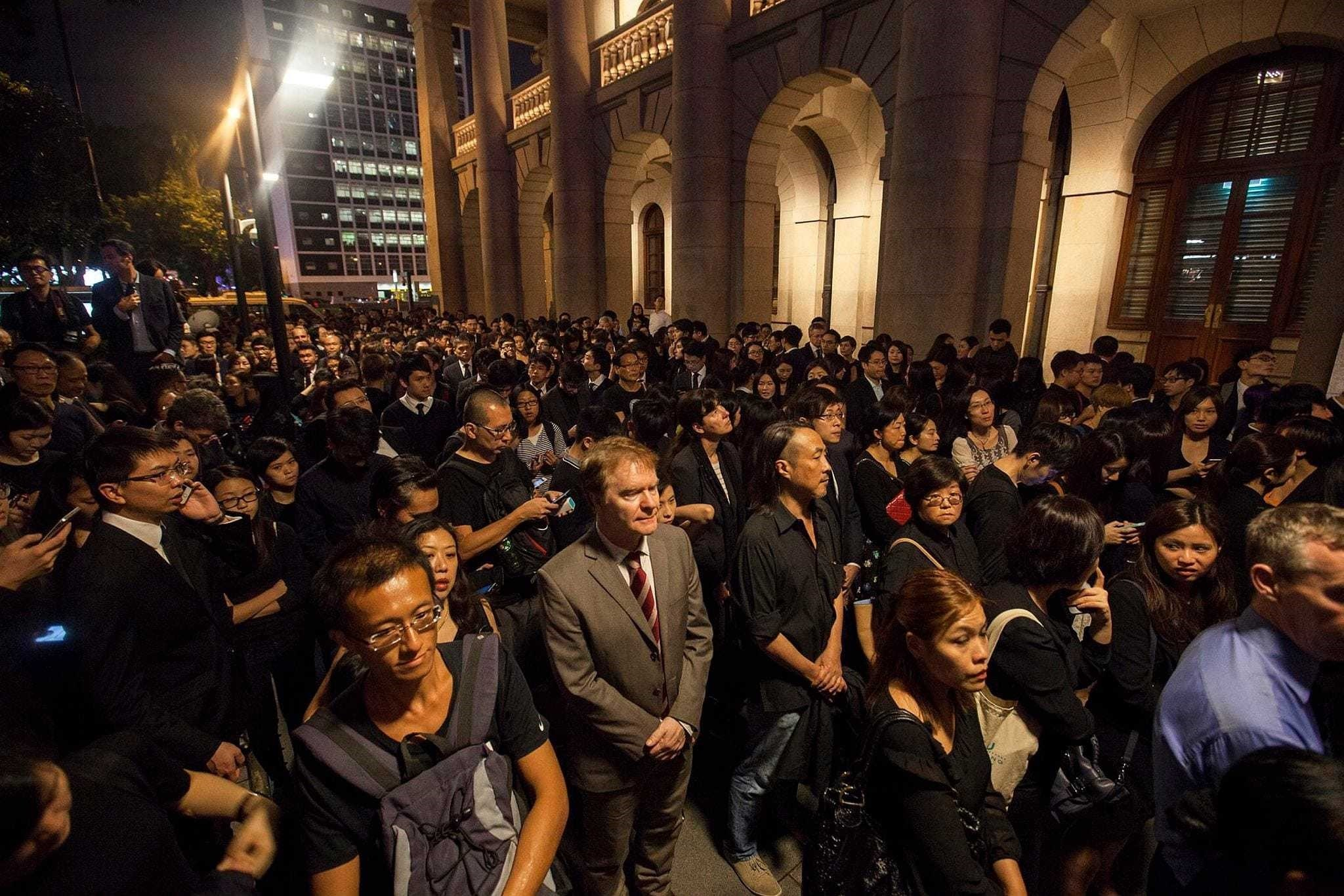 Members of Hong Kongu2019s legal community and law students from the University of Hong Kong gather outside the cityu2019s Court of Final Appeal during a silent protest against China on Nov. 8.