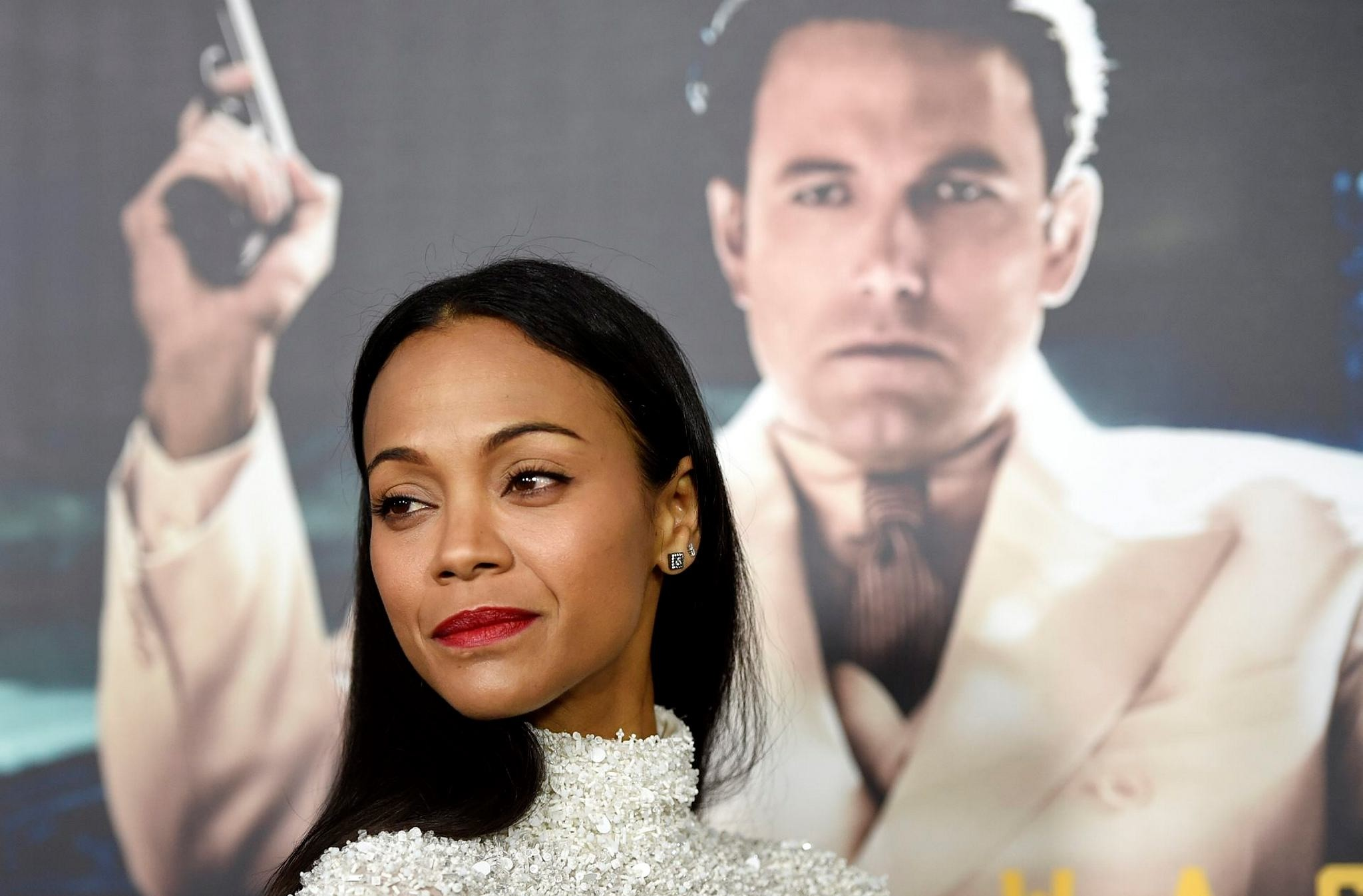 Zoe Saldana, a cast member in ,Live by Night,, poses at the premiere of the film at the TCL Chinese Theatre on Monday, Jan. 9, 2017 in Los Angeles. (AP Photo)