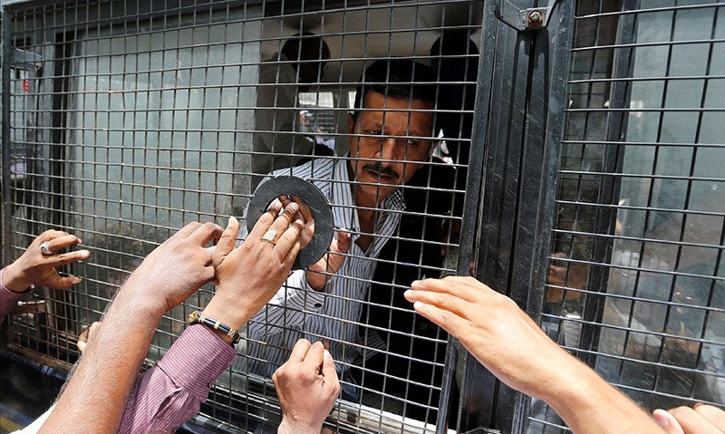 A convict in connection with a riot in Gujarat in 2002 is seen inside a police vehicle at a court after the sentencing in Ahmedabad, India June 17, 2016 (Reuters Photo)