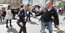 UK man charged with assault over Farage milkshake-throwing