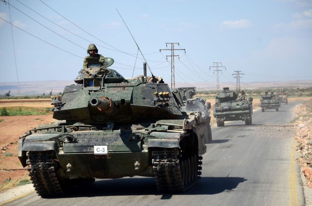 Turkish troops driving their tanks on Sept. 4, 2016 on a road near the Syrian village of al-Waqf and some 3 kilometers south of al-Rai, the small border town with Turkey.