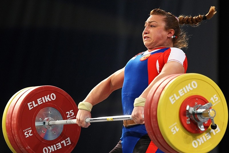 A file picture dated 10 April 2010 of Russia's Nadezhda Evstyukhina competing in the women's 75kg category during the European Weightlifting Championships in Minsk, Belarus (EPA Photo)