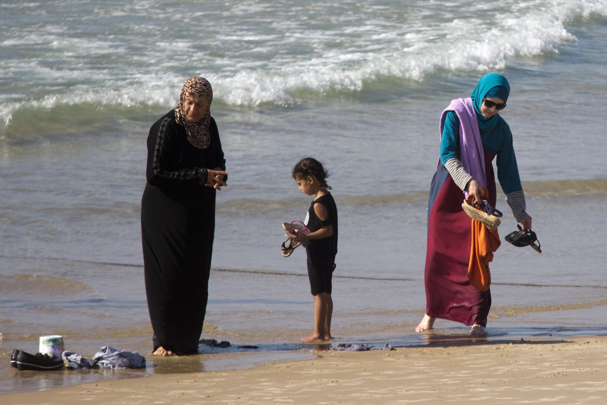 In this Friday, Sept. 2, 2016 photo, Muslim women stand at a beach in Tel Aviv, Israel. (AP Photo)