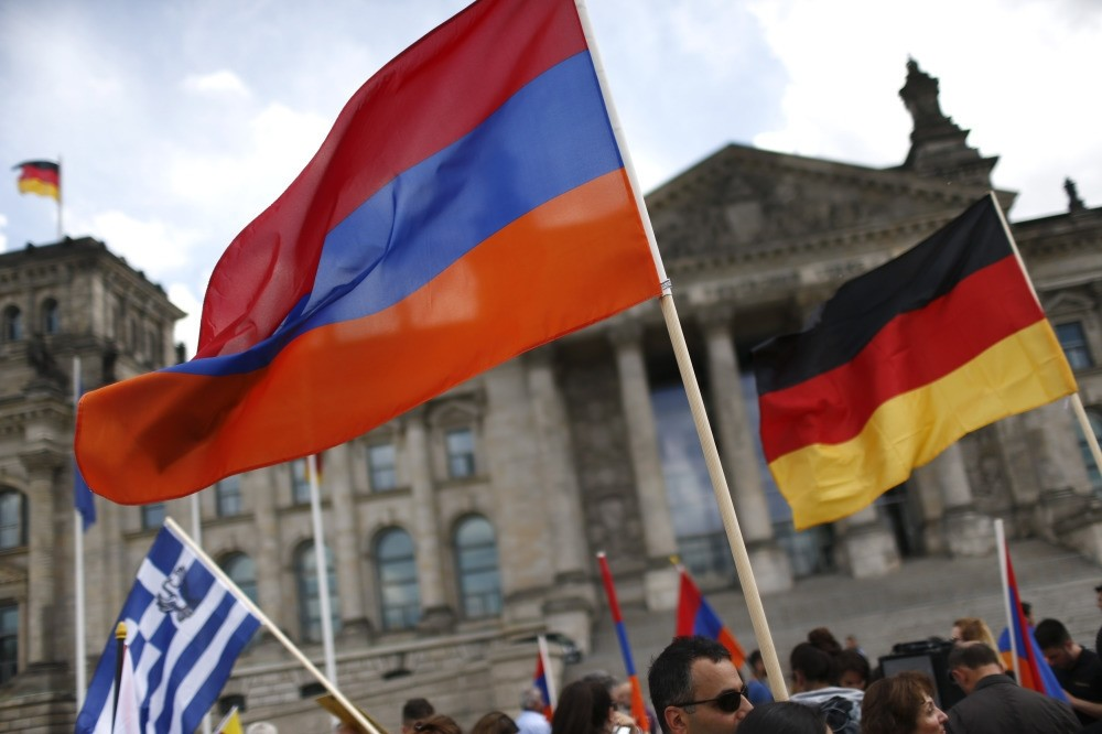 People waving Armenian and German flags in front of the Reichstag in Berlin as they protest in favor of the decision by German parliament that defines the 1915 Armenian incidents as 'genocide'.