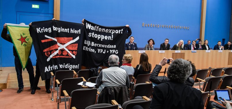 PKK-LINKED PYD SUPPORTERS STORM GERMAN GOVT OFFICIALS NEWS CONFERENCE