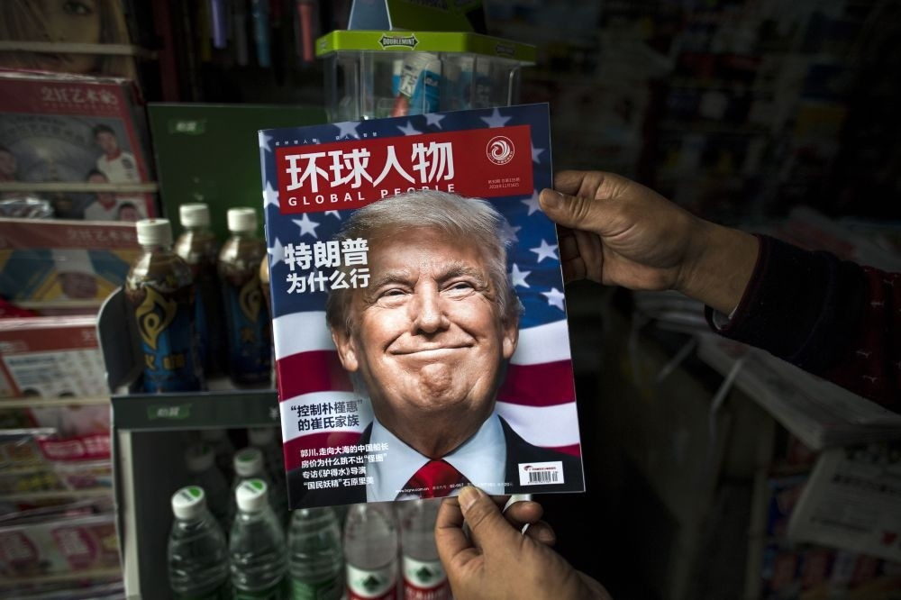 A copy of the local Chinese magazine Global People with a cover story that translates to ,Why did Trump win, at a news stand in Shanghai, Nov. 14, 2016.