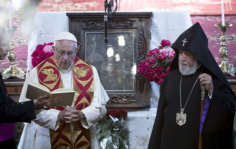 Pope Francis and Catholicos Karekin II visits the Armenian Apostolic Cathedral of the Seven Wounds in Armenia's second-largest city of Gyumri Saturday, June 25, 2016. (AP Photo)