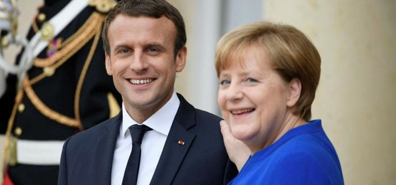 GERMANY, FRANCE, RUSSIA, UKRAINE VOW TO IMPLEMENT PEACE PLAN