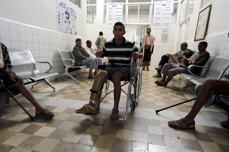 A disabled young Yemeni of the on-going conflict victims (C) waits for treatment at a rehabilitation center on International Day of Innocent Child Victims of Aggression, in Sanau2019a, Yemen, June 4, 2016  EPA Photo