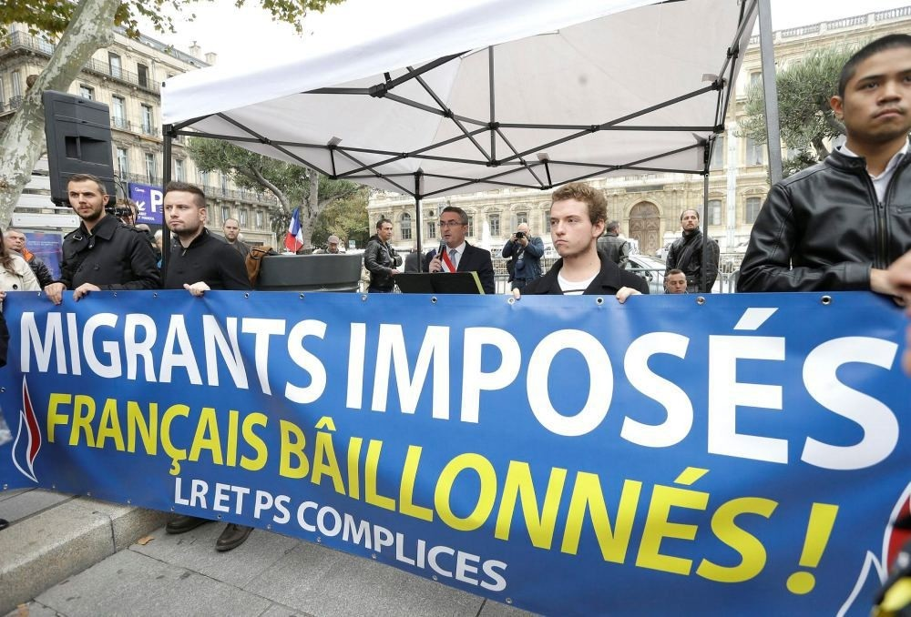 Far-right National Front party holds anti-immigrant demonstration in Marseille, southern France, Nov. 5 as banner reads, ,Migrants imposed, French gagged, Les Republicans party and Socialist Party partners.,