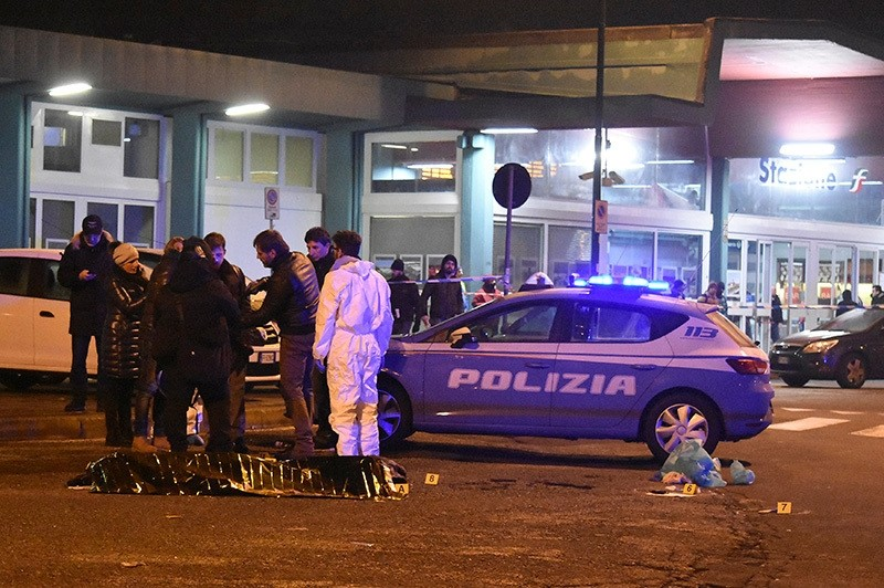 Italian Police officers work next to the body of Anis Amri, the suspect in the Berlin Christmas market truck attack, in a suburb of the northern Italian city of Milan, Italy Dec. 23, 2016. (Reuters Photo)