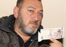 ATM'den çektiği kesim hatalı 5 lirayı dört yıldır saklıyor