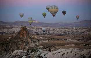 Thousands of visitors flock to Cappadocia to enjoy magnificent scenic by taking hot-air balloon trips
