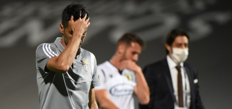 BENFICA HELD TO DRAW TO LEAVE PORTO ON VERGE OF TITLE