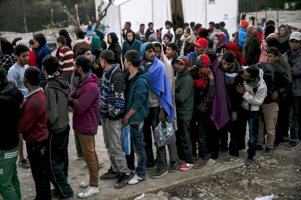 Refugees line up for food distribution at the Moria refugee camp on the Greek island of Lesbos, Nov. 5, 2015.