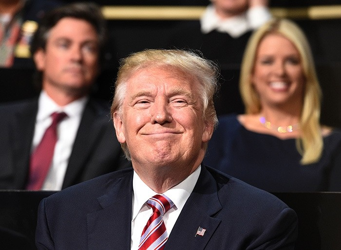 Republican presidential candidate Donald Trump smiles on day three of the Republican National Convention at the Quicken Loans Arena in Cleveland, Ohio on July 20, 2016. (AFP Photo)