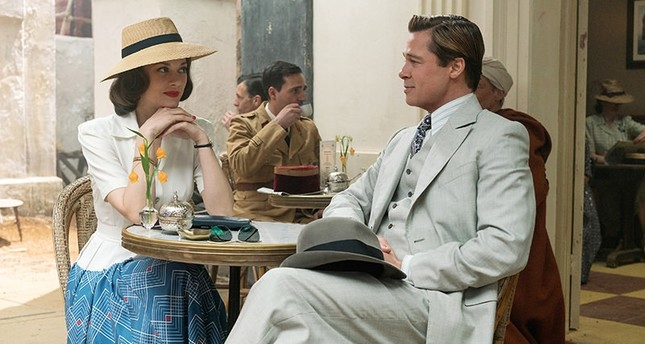 Marion Cotillard (L) and Brad Pitt in a scene from, Allied, in theaters on November 23. (AP Photo)