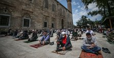 Turkish mosques reopen for mass prayers as virus curbs ease