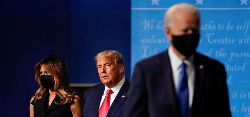 BIDEN ACCUSES TRUMP OF GIVING UP IN COVID FIGHT