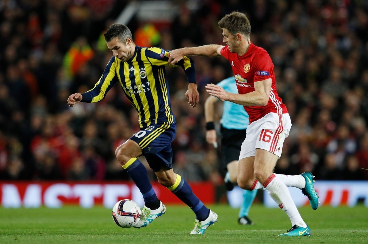 Van Persie in action with Carrick