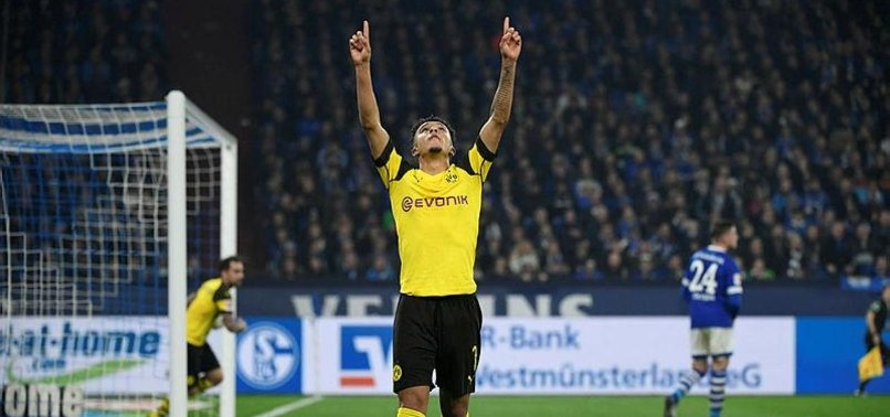 LEADERS DORTMUND EDGE SCHALKE IN DERBY, BAYERN WIN