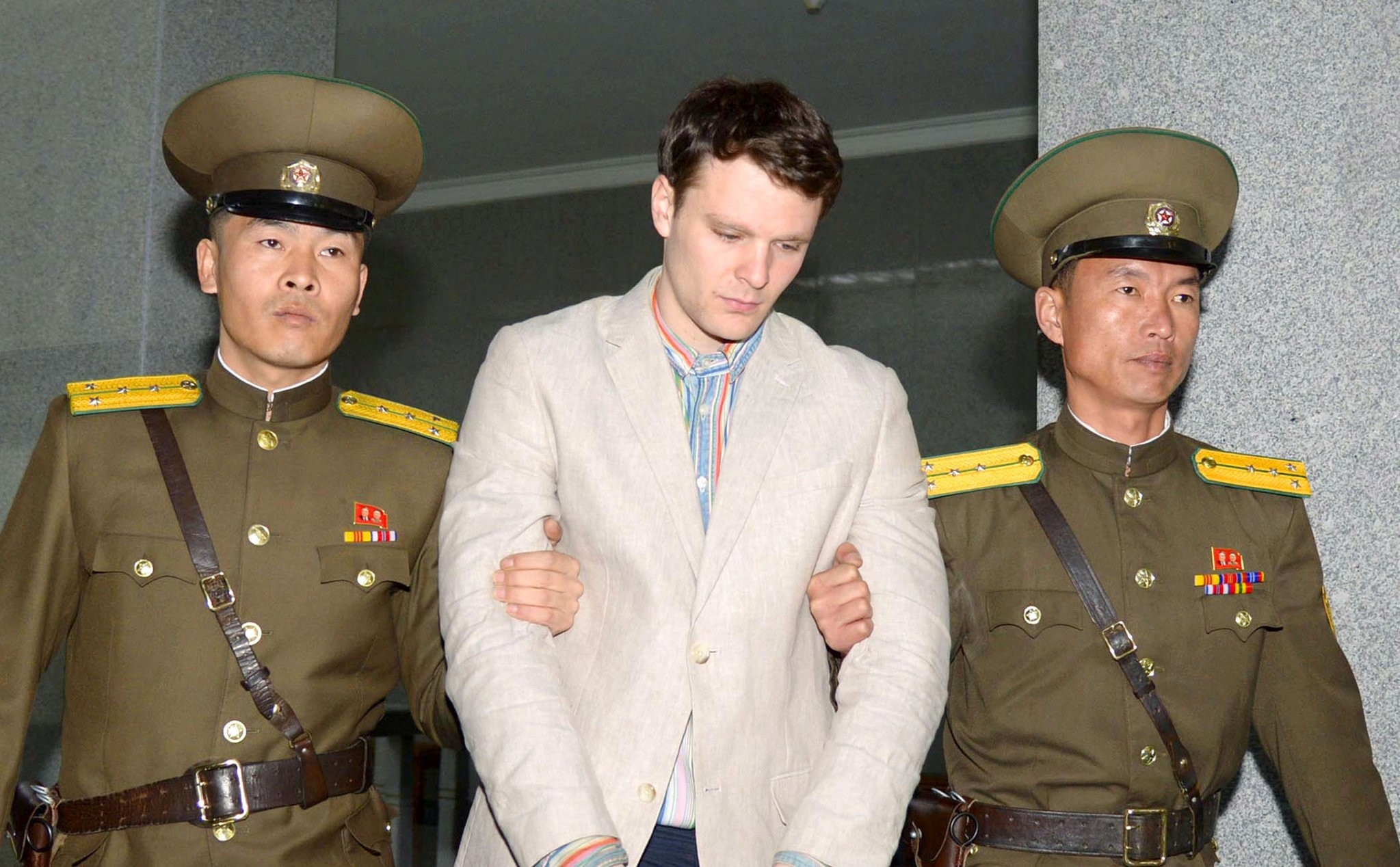 Otto Frederick Warmbier (C), a University of Virginia student who was detained in North Korea since early January, is taken to North Korea's top court in Pyongyang, North Korea, in this photo released by Kyodo March 16, 2016. (REUTERS Photo)