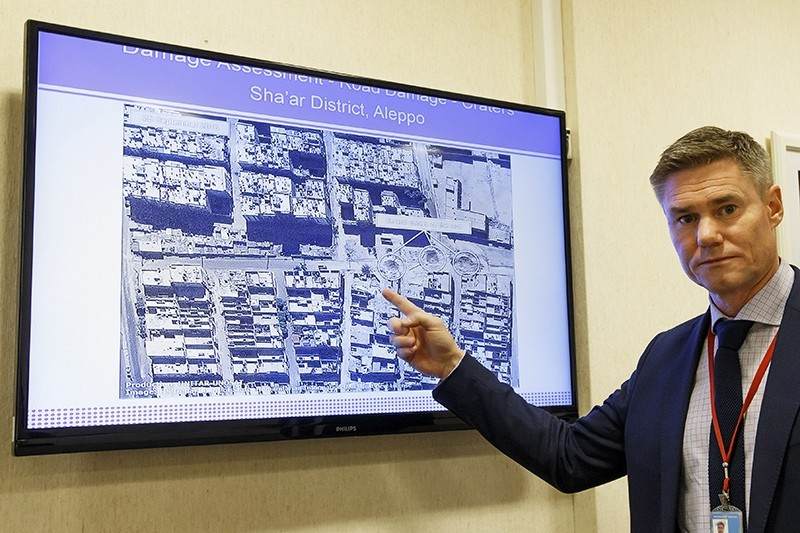 Einar Bjorgo, UNOSAT manager, shows a satellite image of a destroyed road of a district in Aleppo, which was taken on Sept. 26, 2016 during a press conference (AP Photo)