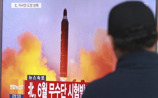 In this Oct. 16, 2016, file photo, a man watches a TV news program showing a file image of a missile launch conducted by North Korea, at the Seoul Railway Station in Seoul, South Korea. (AP Photo)
