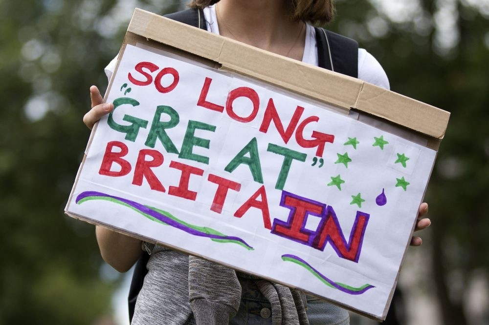 A demonstrator holding a placard that reads u2018So Long Great Britain' during a protest against the pro-Brexit outcome of the U.K.'s June 23 referendum, in London on June 25, 2016.