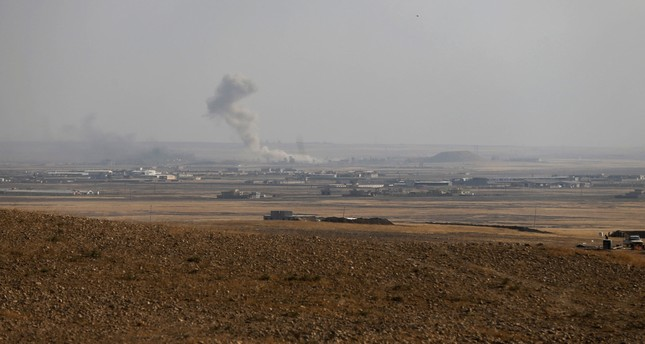 Smoke rises from clashes at Bartila in the east of Mosul during clashes with Daesh militants, Iraq, October 18, 2016. (REUTERS Photo)