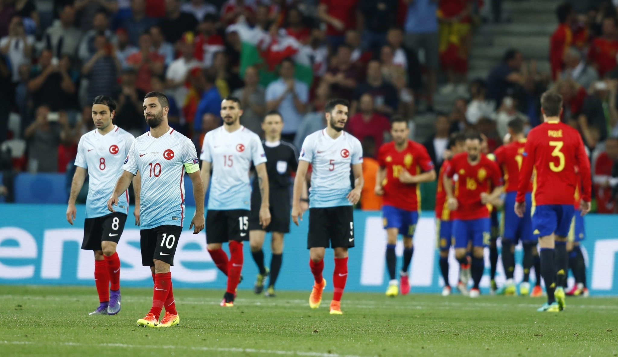 Turkey's Arda Turan reacts after Spain's Alvaro Morata (not pictured) scores their third goal  (REUTERS Photo)